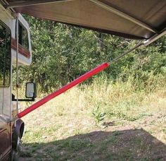 Slit foam swim noodles lengthwise and slip over each awning strut. No more bonked heads. + 40 more camping ideas & hack's.