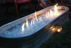 Hillbilly fire pit.  Horse trough with natural gas fire, clear fire glass that looks like ice.