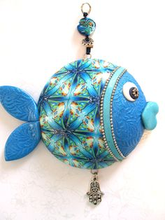 Wall decor fish, lucky fish, fish of fortune, Polymer clay handmade fish in blue, turquoise, green, white and silver. $40.00, via Etsy.