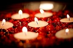 Tealights set amid cranberries.  I bet this will work with red heart-candies, too.