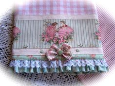 Lace tea towel with bow.