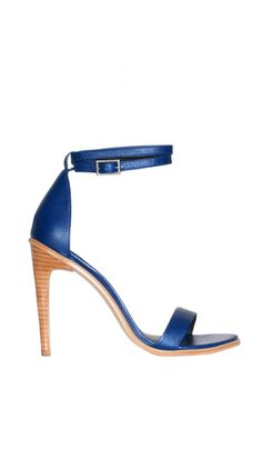 Tibi Amber ankle sandal in blue leather with adjustable buckle closure. Stacked natural wooden heel. Natural wooden welt and outsole. Made in Brazil. Fabrication:100% Leather.    Style number: SS214AMB1772