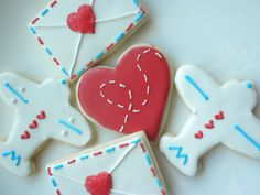 whimsical travel themed cookies for a vintage themed sweets table