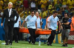 Stretchered off: Neymar is carried away by medics leaving all Brazilian fans in a state of...