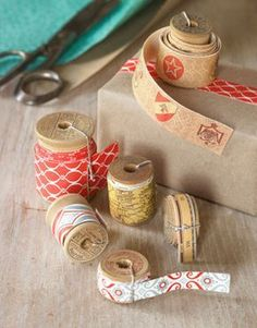 """""""DIY Decorative Tape"""" : To make rolls of pretty tape, round up your favorite patterned wrapping paper, and purchase double-side mounting adhesive. You'll also need a new or vintage spool. 