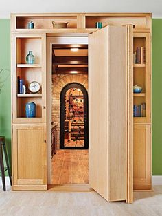 Like a moll in a mystery novel this beautiful swinger has a secret. A pivoting bookcase installs over an existing doorway to conceal your hideout secret passageway or ill-gotten gains. Featured in WOOD Issue 236 November 2015 Hidden Bookshelf Door, Bookcase Door, Bookshelf Design, Door Shelves, Shelving, Storage Shelves, Bookcase Plans, Passage Secret, Panic Rooms