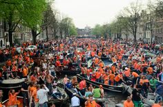 Queen's Day (Netherlands). 'On April 30, more than one million revellers descend on Amsterdam for the freakingest street party in Europe.  Queen's Day (Koninginnedag) celebrates the monarch's birthday, but that's really just the excuse for a gigantic drinking fest, and for everyone to wear ridiculous outfits in orange, the country's national colour.' http://www.lonelyplanet.com/the-netherlands/amsterdam