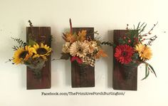 Floral arrangements.  Upcycled rusty vintage oil can and bed spring.  Summer to fall decor. 14.5 tall. $24 each.