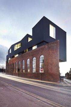 Shoreham Street building, Sheffield, England;  a Victorian industrial brick building with a new modern upward extension;  designed by Project Orange