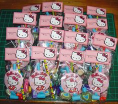 AMAZING idea for favors....use celophane treat bags and top with personalized hello kitty toppers with birthday girls name! LOVE this!
