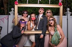 Hanging Photo Frame | Community Post: 15 Insanely Awesome DIY Wedding Photo Booth Backgrounds