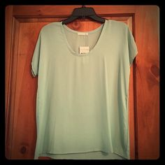 """Green shell too This piece has never been worn! Pretty green (""""sprout"""") shell top perfect for under suit jackets. Soprano Tops Blouses"""