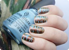 Nailpolis Museum of Nail Art | Watermarble without water by Romana Nail Polish Used: China Glaze Electric beat, Miss Sporty Metal Flip 050