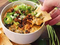 The ultimate party snack, now in a 100% animal product-free form. This vegan queso dip is packed with a gooey cashew and potato-based nacho sauce, soy-lentil chorizo, avocados, scallions, tomatoes with chilies, and black beans. The flavor is so good even your omnivore friends won't know that it's vegan. How do I know? Because I even tricked my avowed meat-eating friend to dig in before telling him that it was vegan. It's that good.