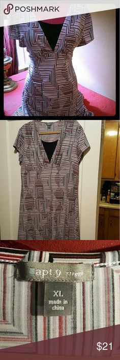 Great red, black, and white print v neck dress I love this dress! It washes very well, wrinkle free. V-neck with an insole black that makes it very conservative for work but so flattering. Smoke-free home, no Ritz, no tears, no stains, this looks great on. Apt. 9 Dresses Midi