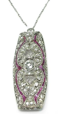 Edwardian platinum, diamond, and ruby pin/pendant