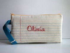 Lined Paper, Writing Paper Fabric and Hand-Embroidered Name. Pencil Case, Pencil Pouch, Wristlet. Personalized. $30,00, via Etsy.