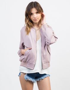If you don't own one already, this Canvas Bomber Jacket is so necessary. This jacket looks pretty amazing with a slip cami top, denim shorts, and a pair of sneakers!