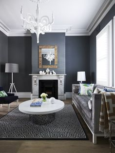 Great Reminiscent of Baroque Residential Project by Greg Natale : Amazing Details Interior White Chandelier White Marble Framed Fireplace Dark Grey Wall Brown Framed Mirror Geometric Pattern Black And White Rug White Coffee Table White