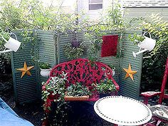 upcycling old shutters in the garden, outdoor living, repurposing upcycling, Cathy Cove used them as a brilliantbackground for her garden vignette