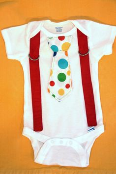 Polka Dot Circus Suspender Tie Onesie. $18.00, via Etsy.
