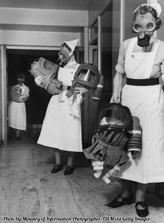 Gas masks for babies are tested during a gas drill at a London hospital, 1940.