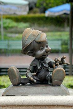 Pinocchio & jiminy cricket statue