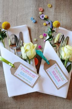 Cutlery pocket with kraft paper luggage tag place name card & brightly coloured ribbon, flowers  & buttons to dress - Dasha Caffrey - A colourful village hall wedding in Kent with lots of DIY and a tea length wedding gown. Photography by Dasha Caffrey.