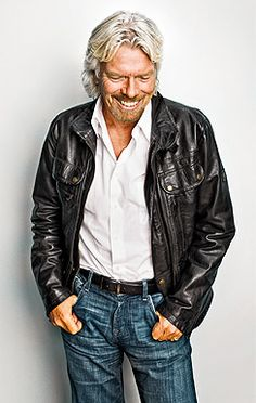 """rock & roll"" casual:  leather jacket, button down open-neck shirt, dark jeans. (Richard Branson)"