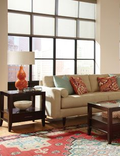 Sheer #shades let the light shine in and highlight the orange tones of this living room