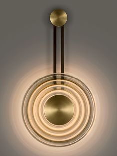 Solar wall light from Chelsom in Black Bronze with English Brass accents and smoke glass