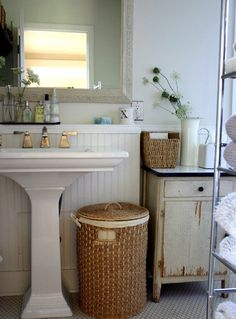 No Excuses: Stylish & Organized Small Space Bathrooms - basket under pedestal sink.