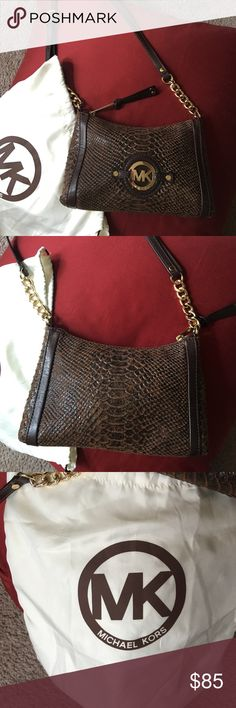 Darling Michael Kors cross body purse! I carried this bag twice! Like NEW on the outside with no scratches or marks to the hardware. Brown snakeskin. Minor marks on the inside but very minimal. Stored stuffed and dust bag comes with it! KORS Michael Kors Bags Crossbody Bags