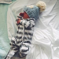 newborn baby boy coming home outfit. Chunky knit pompom hat. striped sleeper