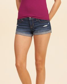 Comfy shorts in dark wash with fading and whiskering, hand-done destruction…