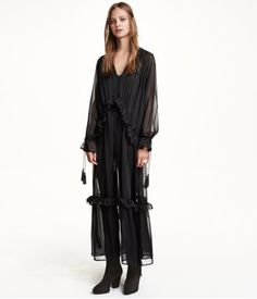 Maxi dress in crêpe chiffon. V-neck and button placket with covered buttons, seam with flounce and drawstring at waist and hem, and high slits at sides. Long raglan sleeves with flounce and drawstring at cuffs.