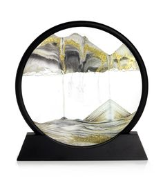 sands of time rotational glass. Just rotate it to form the mountains, then rotate it again to form the seas