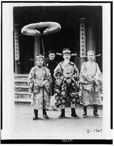 Annamite mandarins,ceremonial attire,holding parasol,Hue,Annam,government,c1930