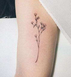Des petites fleurs à l'intérieur du bras - Cosmopolitan.fr