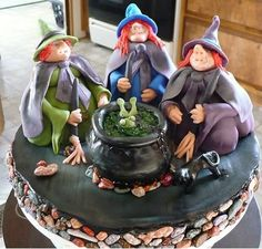 3 witches and Calderon are made from the Wilton's doll pan. Cooking up what seems like frog stew. The rocks are chocolate candy.  Lots of fun with this one.