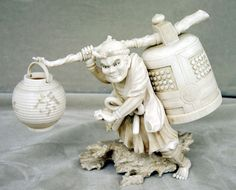 This finely carved okimono features a man walking over rocks, carrying a large bell and paper lantern. This piece was carved by the artisan Muneyuki in Japan during the 19th century. The piece is carved in exquisite detail; the okimono is composed of several separately carved pieces pieced together. The figure measures approximately 7 inches length. Muneyuki's signature appears on the underside of the base.