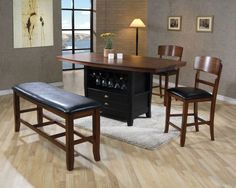 $699.99 Andrew 5 Piece Counter Height Table Set 2749-SET. The Andrew Table Top dining collection puts emphasis on clean straight lines that are representative of modern furnishing styles. The table in this collection features a unique and eye-catching single pedestal base, which holds up the sleek round top. The matching chairs are upholstered in a warm tan fabric for maximum comfort. Update your dining room decor with the contemporary appeal of the Andrew collection.