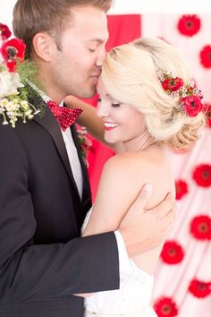 Romantic Bridal Updo with Red Flowers and a Floral Backdrop | Amy and Jordan Photography | heyweddinglady.co...