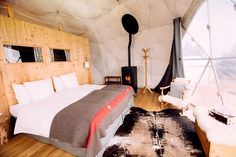 All the pods are equipped with organic bedding and efficient pellet wood‑burning stoves adding to the cozy interiors.