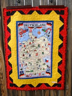 GERMANY map quilt by HeritageAndHeart, surrounding  borders in the colors of the German flag... black, red, and yellow.