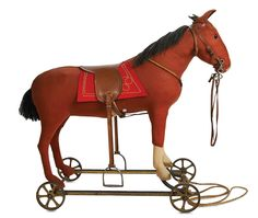 German Brown Woolen Riding Horse on Metal Wheels by Steiff. early 20th century. http://Theriaults.com