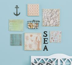 We got this under-the-sea gallery wall off the ground with an assortment of gesso board and painting panels and a pack of mad-for-maritime paper