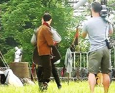 Colin with Bradley, goofing around behind the scenes of BBC Merlin.