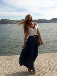 Simple white top with blue maxi skirt and nude accessories.