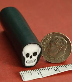 Polymer Clay Skull Cane 'Mortal Coil'. by ikandiclay on Etsy